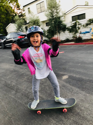 Patrick's daughter, Juri, riding her skateboard